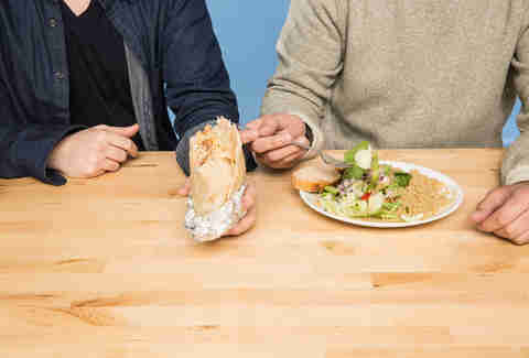 two men eating chipotle and salad