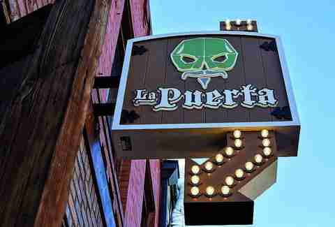 la puerta sign light up arrow san diego thrillist