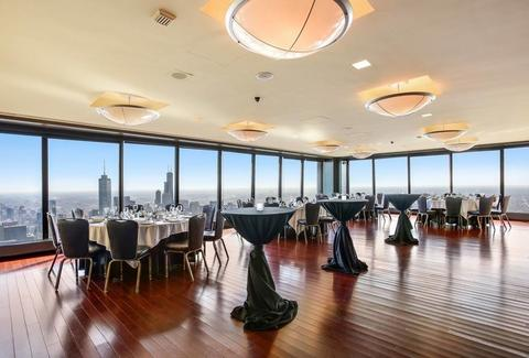 The Signature Room at the 95th open room large windows round and tall tables