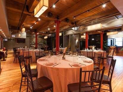 Sunda interior dining space round tables chicago thrillist