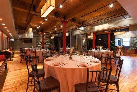 Sunda interior dining space round tables chicago thrillist