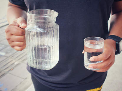 Man holding water cup