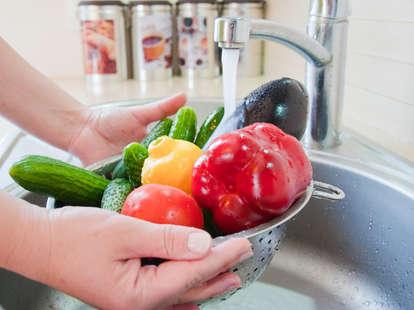 Person washing vegetable