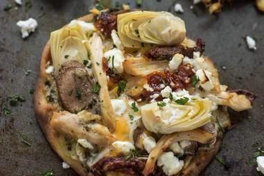 pesto chicken artichoke pizza