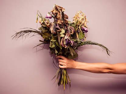 Dead flowers in hand