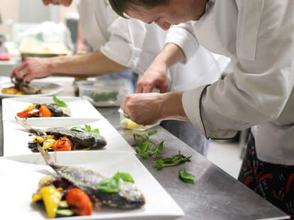 Chefs preparing ingredients