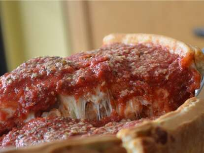 The Art of Pizza Chicago deep dish slice with a lot of sauce thrillist