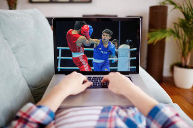 streaming a boxing match on a laptop