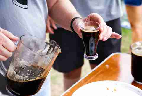 pitcher of stout beer at festival