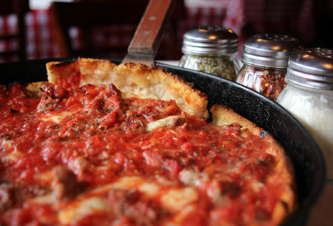 Pizano's Pizza deep dish chicago cutting a slice thrillist