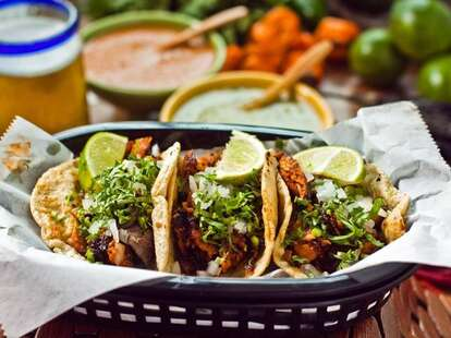 La Lagartija Taqueria 3 tacos in basket thrillist chicago