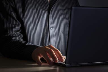 man on computer a night