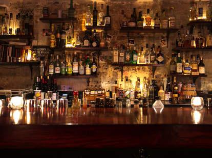 happiness forgets london thrillist long bar bottles on shelves