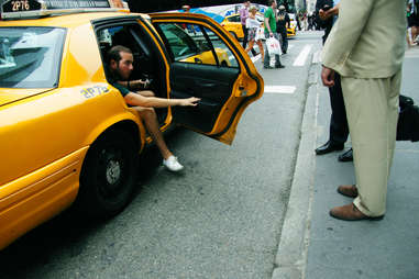man getting out of taxi cab