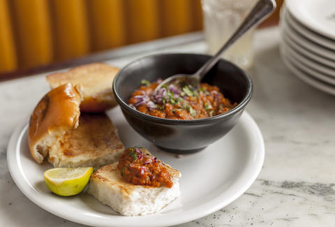 Dishoom indian sauce and bread on plate thrillist london