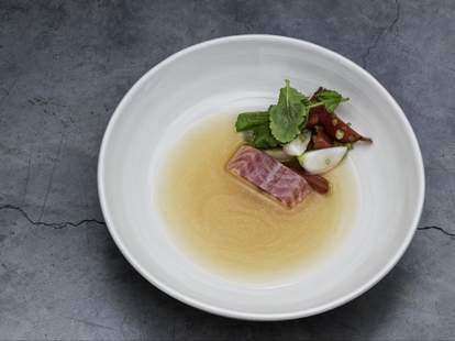 lyle's london thrillist a piece of meat with a leaf on white plate