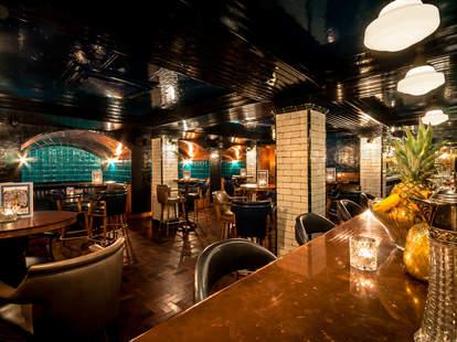 HAWKSMOOR restaurant interior bar and tables thrillist london