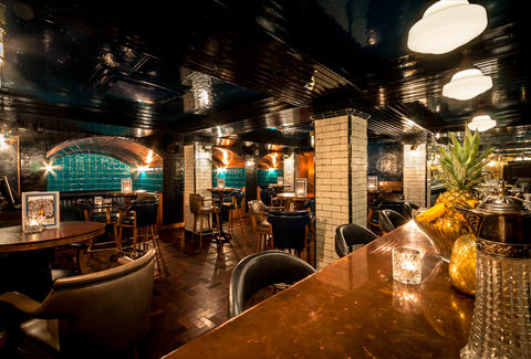 HAWKSMOOR restaurant interior bar and tables thrillist london