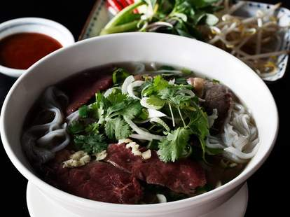 soup vietnamese food in white bowl garnished thrillist london