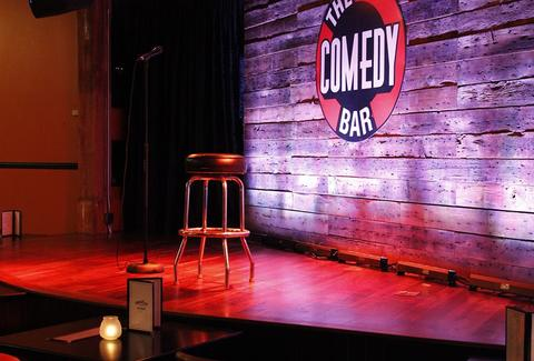 The Comedy Bar red spotlight stage chicago thrillist