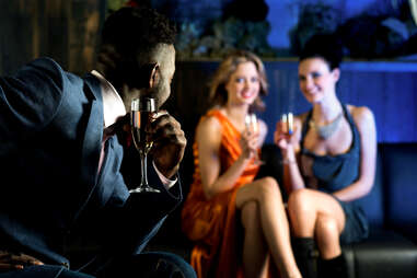 man and two woman and a club drinking