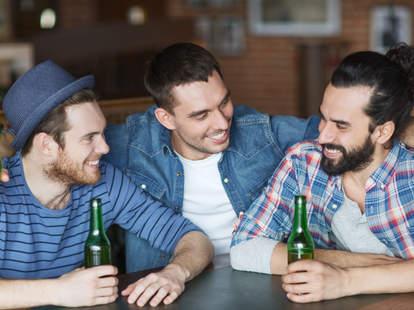 guys drinking at a bar