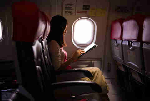 woman on plane on tablet