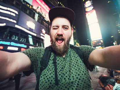 Tourist selfie in Time Square New York City
