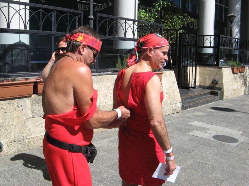 men in red dresses