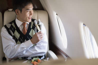 well-dress business man first class airplane