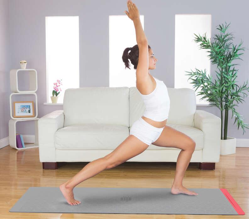 woman doing yoga on smart yoga mat
