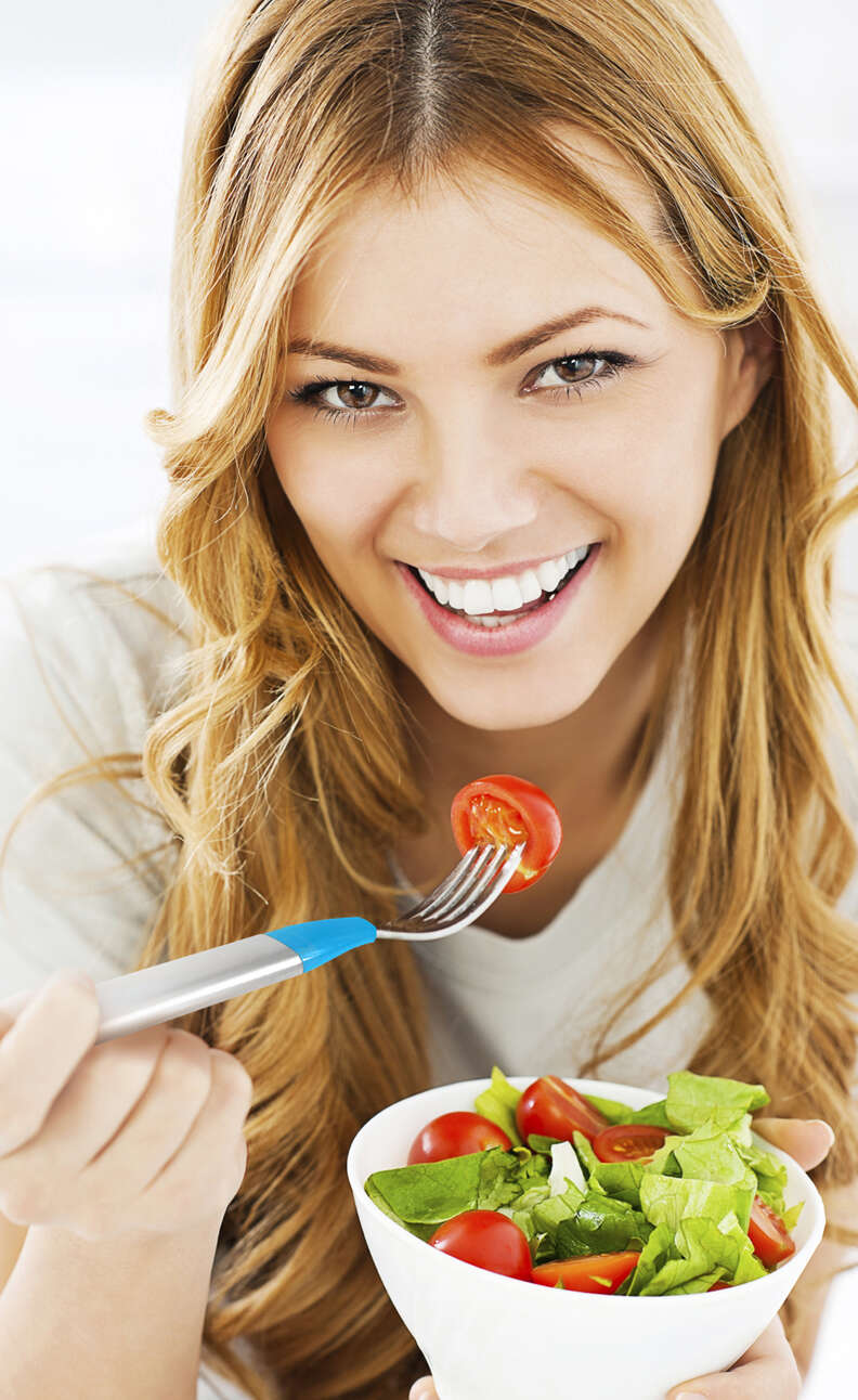 woman eating salad with HAPIfork