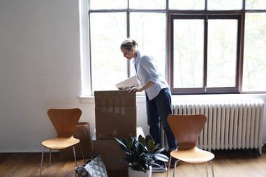 woman unpacking apartment