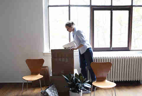 woman unpacking apartment