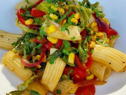 rigatoni with charred brussels sprouts, corn, red onion, sweet peppers, & parm in a white wine sauce