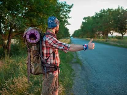 man hitchhiking in europe