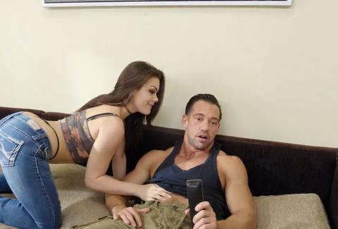 Girl trying to seduce guy on couch