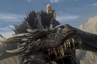 Emilia Clarke as Daenerys Targaryen on her dragon Drogon
