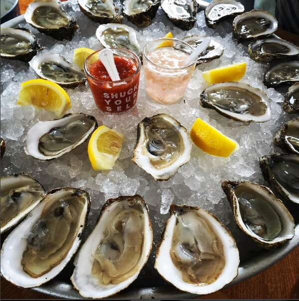 Couple shucking oysters