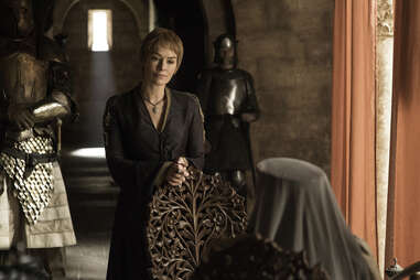 Lena Headey as Cersei Lannister speaks to Diana Rigg as Olenna Tyrell