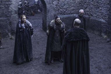 Kit Harington as Jon Snow and Sophie Turner as Sansa Stark negotiate with Tim McInnerny as Robett Glover