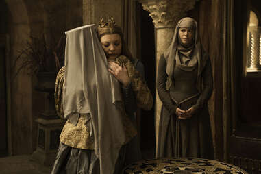 Natalie Dormer as Margaery Tyrell embraces Diana Rigg as Olenna Tyrell after her penance