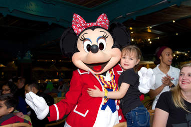 Minnie Mouse and child