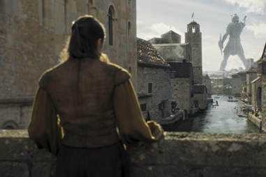 Arya Stark, Maisie Williams, looks at the statue in the port of Braavos