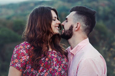 kissing man with beard