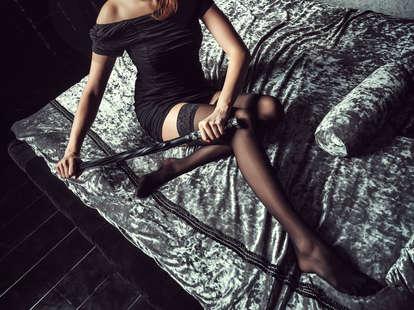dominatrix on bed