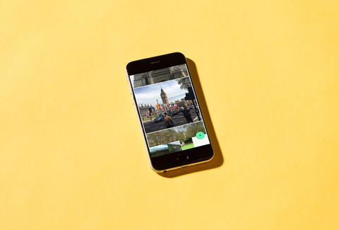 iphone on yellow backdrop with motion stills screenshot