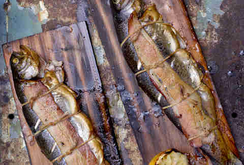 smoked whole fish on a wood plank