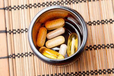 Vitamin pills in a ramekin