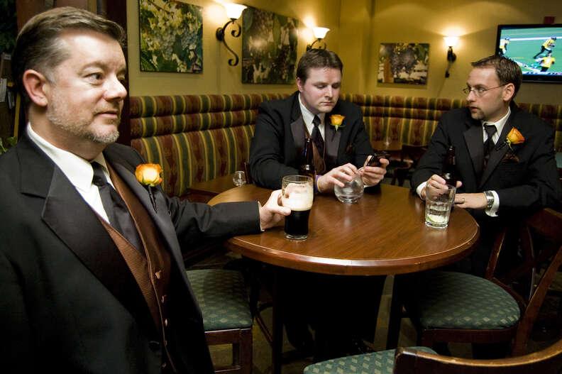 Groomsmen drink before a wedding